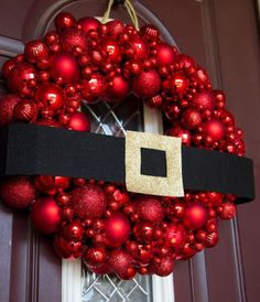 "DIY Christmas Wreath Ideas - Ornament Wreath - What about just wrapping a giant black belt around my already red front door. A new take on a ""wreath"""