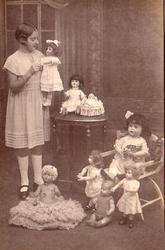 Little girl with dolls