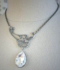 LILY BRIDE romantic vintage fantasy inspired lily asymmetrical bridal necklace with Swarovski crystal, free gift boxing. $38,00, via Etsy.