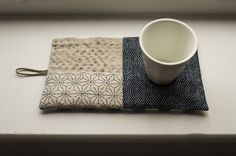 A lovely addition to your kitchen. Made with Japanese fabrics and 100% linen, hemp, 100% bamboo batting. Hand-stitched following my mood (which is usually