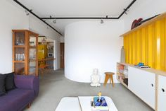 Colorful Family Home Ingeniously Designed on a Budget in Sao Paulo, Brazil - http://freshome.com/2014/12/02/colorful-family-home-ingeniously-designed-on-a-budget-in-sao-paulo-brazil/