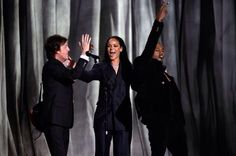 """The powerhouse ensemble of Rihanna, Kanye West and Paul McCartney dazzled with their pop collaboration """"FourFiveSeconds"""" in a relatively stripped-back performance at the Grammys. The former Beatle passionately strummed the tune's propulsive riff, as the singer and rapper sang their verses, joining in on the choruses. The majority of the performance took place in front of a white-light backdrop, until it lifted up to reveal dark curtains."""