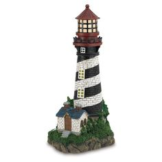 This handsome lighthouse is powered by the sun shining brightly for up to 8 hours long after the sun is down. Solar-powered Lighthouse by Custom Made. #myCustomMade