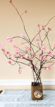 Glue silk cherry blossoms to large branches for a stunning arrangement that will bring spring into your home.