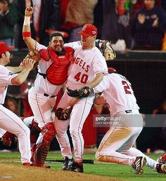 anaheim-angels-catcher-bengie-molina-closing-pitcher-troy-percival-picture-id51669917 (936×1024)