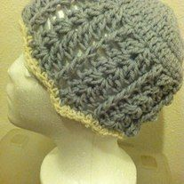 This is a super beautiful blue and cream shell hat! Super cute, warm, and fancy!
