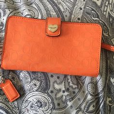 AUTHENTIC COACH LEATHER WRISTLET IN HOT ORANGE Worn a few times but still in excellent new condition. Lovely WRISTLET in hot orange color from coach Coach Bags Clutches & Wristlets