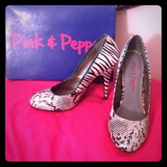 Multi-animal print heels Black and white Zebra/snake patterned heels with real accent. Size 6. Only worn once. Shoes Heels