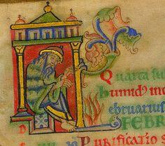 Man warming his feet. calendar February. England c,1150. Psalter. Lansdowne 383. BL