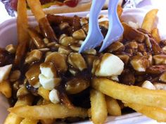 Costco in BC...your membership card will work at any Costco around the world!...Poutine! It's a large portion of crispy fries, fresh out of the deep fryer, topped with rich, steaming hot brown gravy, and a generous amount of cheese curds, for only around four dollars....