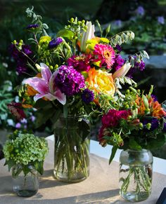 Bright and bold unstructured arrangements are a perfect welcome and will put an instant smile on the faces of your guests #cedarwoodweddings Farmers Market Inspired Farm Wedding at Cedarwood | Cedarwood Weddings