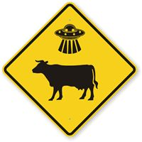 Spotted - Highway 68 Near Taos, New Mexico  UFO Cow Abductions Here! http://www.myparkingsign.com/funny-traffic-signs.aspx