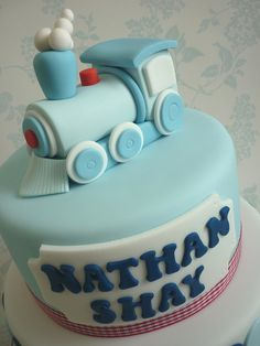 Train Christening Cake close up by The Designer Cake Company, via Flickr