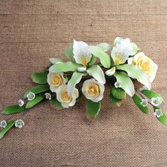 assembling a floral fondant spray | ... for cake decorating fondant wedding cakes and fondant birthday cakes