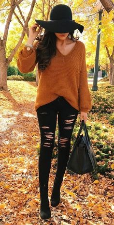 #fall #outfits  women's brown v-neck sweater with black distressed skinny jeans
