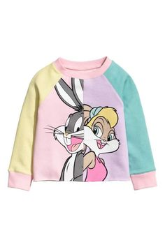 Pink/Looney Tunes. Soft sweatshirt with a printed design. Raglan sleeves and ribbing at neckline and cuffs.