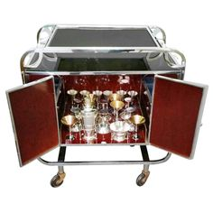 Rare Art Deco Cocktail Trolley with Compleat Accessories   From a unique collection of antique and modern dry bars at https://www.1stdibs.com/furniture/storage-case-pieces/dry-bars/