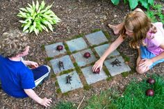 tic tac toe using large plastic insects.