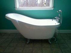 Bathtub by American Bath Factory and the color of the walls is Benjamin Moore Popsicle blue!