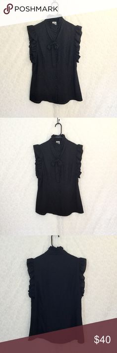 Anne Klein dress blouse Sleeveless with ruffled edges. Ruffled collared. Round buttons with a cut bow tie up front.  Measures 18 1/2 inches arm pit to arm pit and 27 1/2 inches down Anne Klein Tops Blouses