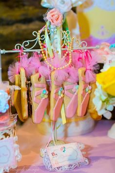 Cute ballet slipper cookies at a Sweet Ballerina Themed 1st Birthday Party with So Many Really Cute Ideas via Kara's Party Ideas KarasPartyIdeas.com