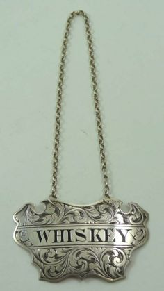 A Victorian Silver Whiskey Decanter Tag