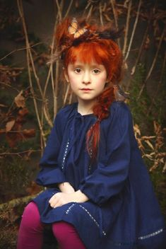 This is such a lovely portrait of a ginger (redhead) little girl. LOVE IT.