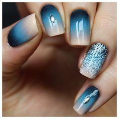Beautiful nude to blue gradient manicure