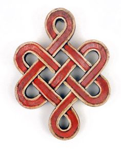 This is a Buddhist wisdom knot. I love infinity knots and infinity symbols, and I especially like this one.
