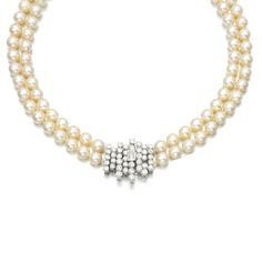 CULTURED PEARL AND DIAMOND NECKLACE Designed as two rows of cultured pearls, to a clasp of abstract design, set with brilliant- and step-cut diamonds, length approximately 600mm.