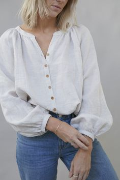A relaxed fit gathered neckline blouse with wooden front buttons, raglan balloon sleeves. Made from medium weight laundered linen in Oatmeal. Mode Ootd, Mode Abaya, Casual Outfits, Cute Outfits, Moda Casual, Designs For Dresses, Minimal Fashion, Blouse Designs, Ideias Fashion