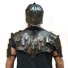 Orc armour.  Back scalemail, shoulders and helmet.  Blued steel and leather. LARP armor
