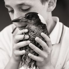 A Friendship Between A Bird And A Boy captured by Cameron Bloom | iGNANT.de