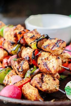 Mediterranean Grilled Chicken Kabobs Recipe + Cayenne Tahini Sauce! Make chicken kabobs like a pro and be the hero of the party! Marinated in Mediterranean spices with fresh garlic and lime juice, these kabobs are simply succulent! Try them for your next party with an easy tahini sauce!