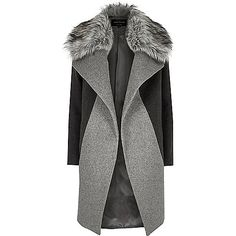 ​Oversized Panelled design Large lapels with faux fur trim Long sleeves