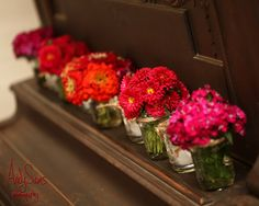 Andy Sams Photography www.andysams.com An Array of Flowers in Jars for Ceremony Decor #ceremonydecor #ceremonyflowers #weddingflowers #weddingdecorideas
