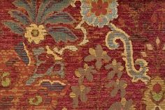 Austwell Curtain Fabric  Luxurious woven chenille floral curtain fabric in deep reds and russet with additions of turquoise and cream