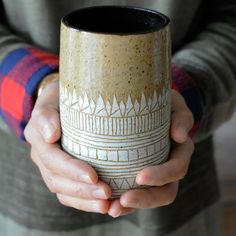 "Hand-built by Lindsey Schneider of Little Bear Pots, this generously-sized piece can be used as a drinking cup and can also double-up as a beautiful vase. Made of Stoneware clay Approx. Size: 2.5"" dia"