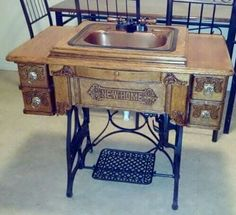 So cool. An old sewing machine turned into a sink.