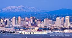 Dusk settles on downtown San Diego with snow-covered Mt. Laguna in the distance.  Image ID: 26716