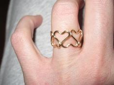 This ring is so cute! Its made to order so SELECT YOUR RING SIZE AND COLOR! Its handmade and wire wrapped into this fun hearts ring in a thicker guage wire. its wrapped up in your choice color sturdier thicker gauge wire Its made with rightside up and upside down one after the other in