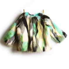 This Bebe de Pino shaggy faux-fur coat comes in a vibrant, rich multi-toned colours in mint and black. Statement piece of the season.