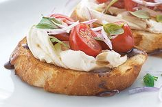 Cream cheese, tomatoes and balsamic vinegar give this tasty bruschetta a creamy, zingy twist. Get a loaf of French bread and win some fans!