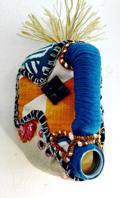 Shop our collection of beautiful textile African masks, handmade from upcycled containers and embellished with an assortment of local fabrics and other media by local artisans in Hout Bay, South Africa. Quirky Gifts, African Masks, Artisan, Banana, Textiles, Concept, Fabric, Leather, Handmade
