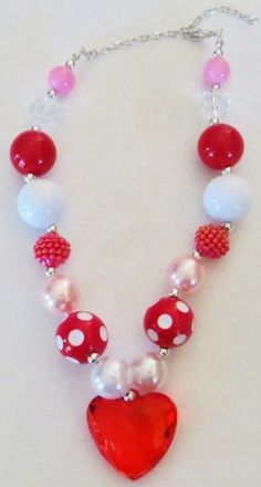 Little girls love jewelry too!   Girls love these Bubblegum Valentine Necklaces. Great quality and makes the perfect touch to her Valentine's Day outfit