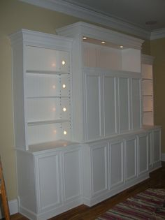 entertainment center - combination of open/closed shelving with lights. but maybe not painted but with wood