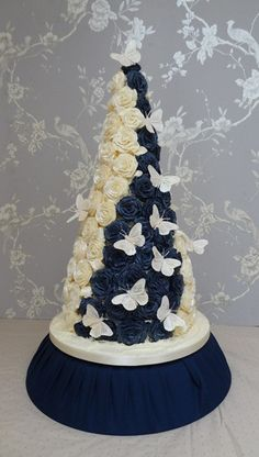 """""""ALICE"""" conical wedding cake in navy & ivory roses  by cakes from the sweetest thing (Susan), via Flickr"""