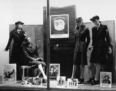 Supporting the war effort, this patriotic store window from the 1940's pays homage to the various women's uniforms of WWII.