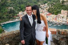Couple in Portofino after a civil wedding on the castle Brown