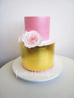 Two tier pink and gold wedding cake